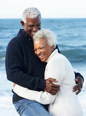 Romantic Senior Couple Hugging On Beach