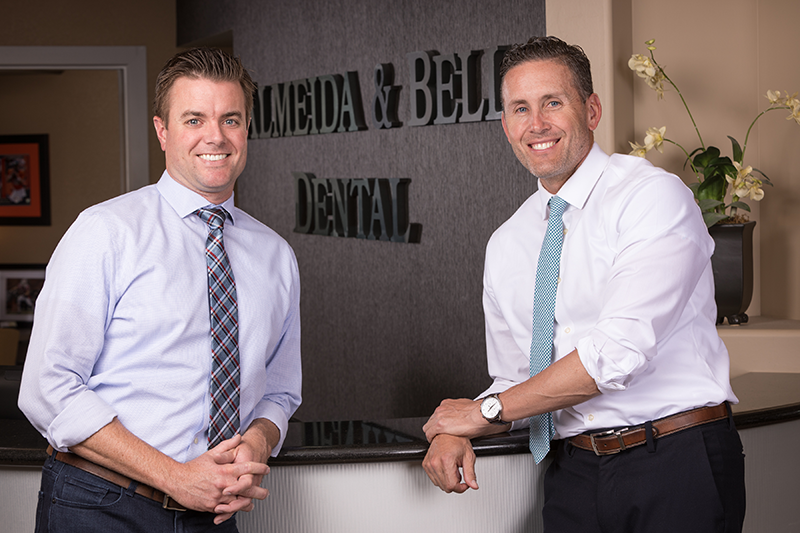 Cosmetic dentists Dr. Adam Almeida and Dr. Paul Bell at Almeida & Bell Dental Cosmetic, Implant & Sedation Dentistry  in Lone Tree.