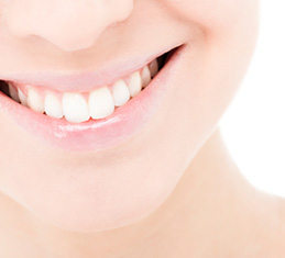Denver patient has white teeth after receiving cosmetic dentistry treatment near Highlands Ranch.
