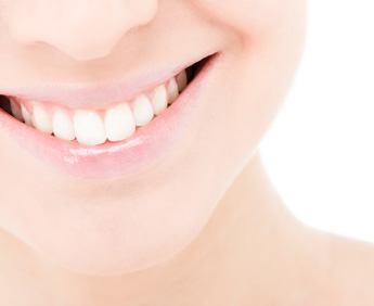 Smiling patient who received porcelain veneers from a dentist near Denver.