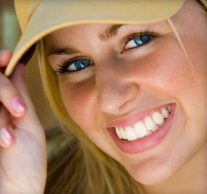 Patient shows off porcelain dental veneers she got near Denver.